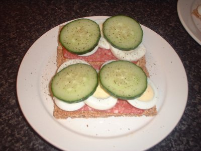 ryvitas with salami, boiled egg and cucumber slices